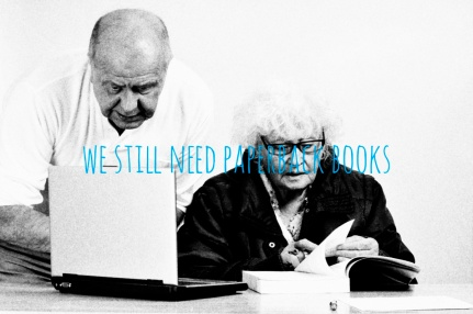 Two elderly men working on paper works and a laptop
